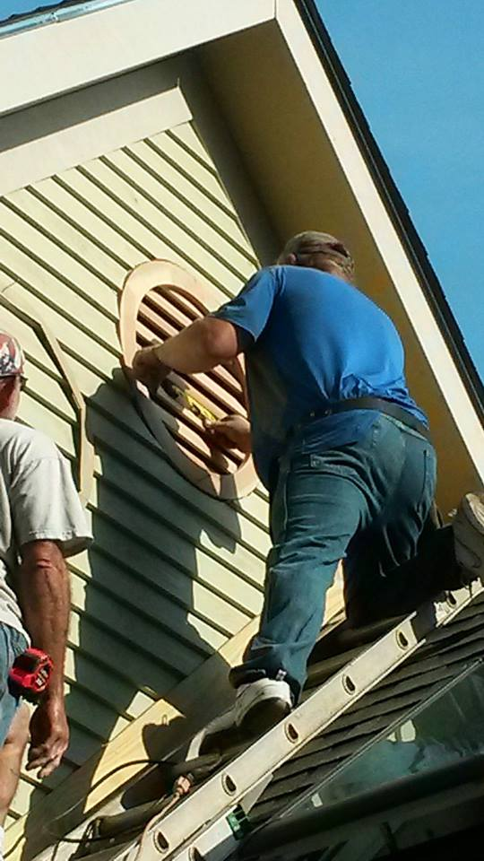 Cut Wood Siding around a Round Louver