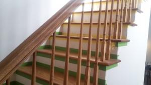This interior stair railing that serves as guardrail and handrail.